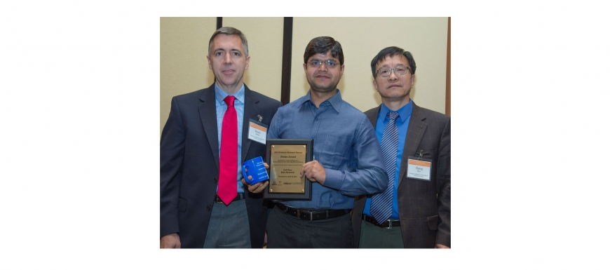 Dr. Rajneesh Jha won the 2nd Place Poster Award - 2014 Carousel Photo