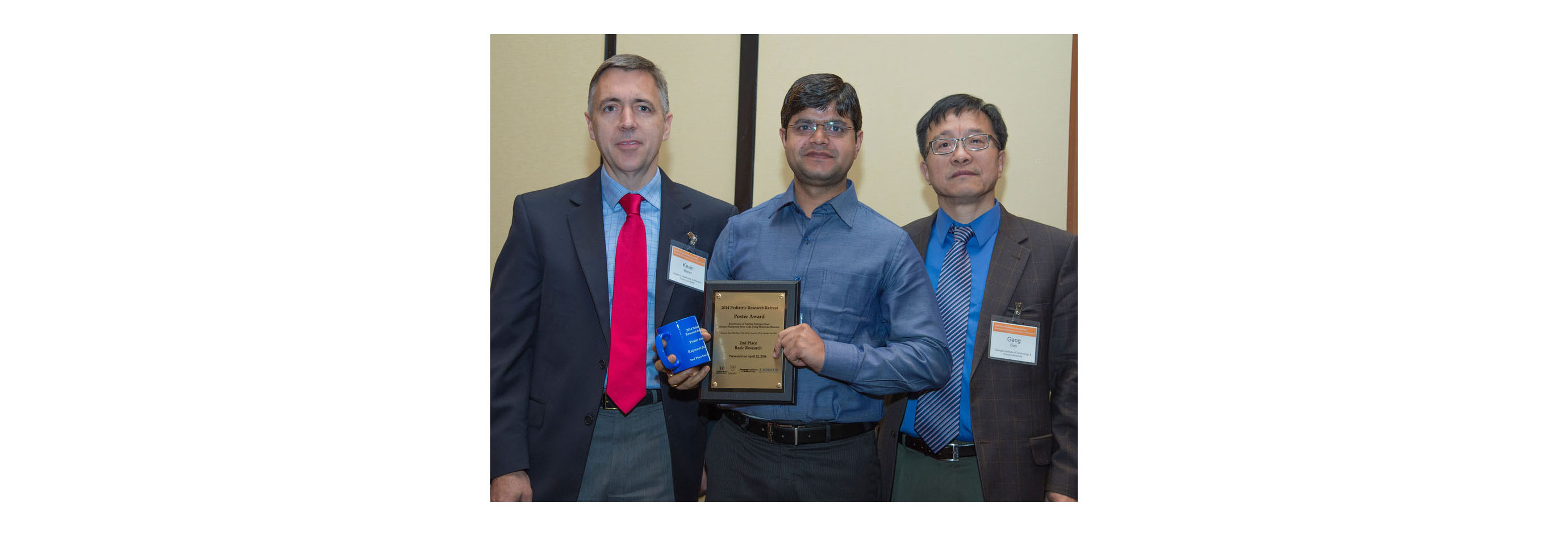 Dr. Rajneesh Jha won the 2nd Place Poster Award Carousel Photo