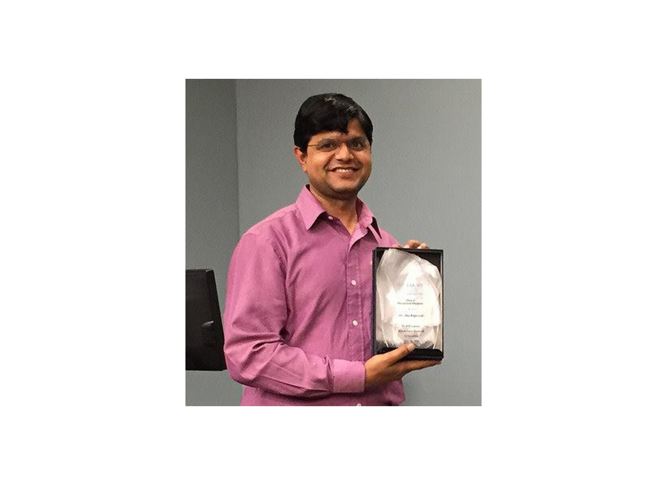 Dr. Rajneesh Jha won the Oral Presentation Award - 2015 Carousel Photo